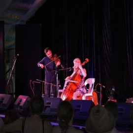 Monique Clare performing at Woodford Folk Festival with Joe D'Esposito